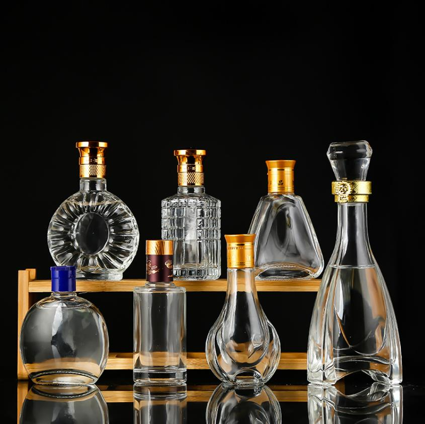 酒瓶生产厂家,酒瓶电镀喷涂厂,酒瓶丝印烫金厂,酒瓶打磨抛光厂